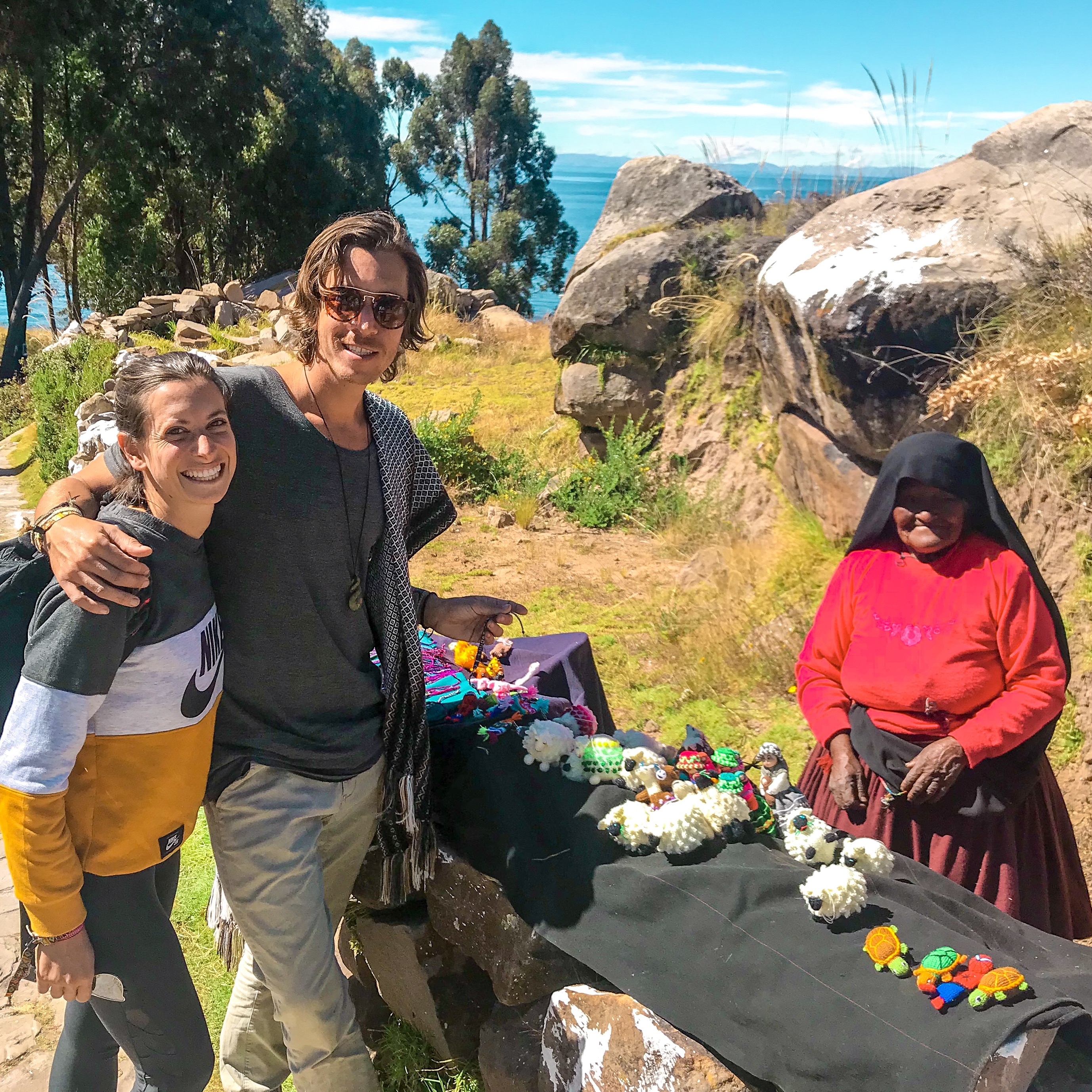 Taquileños woman on Taquile Island, Lake Titicaca Peru, selling her artisan goods. Peruvian culture preservation.